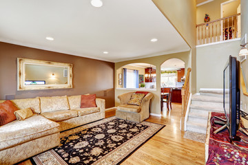 Living room with comfortable creamy tone sofa and tv