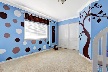 Cheerful murals in baby room.