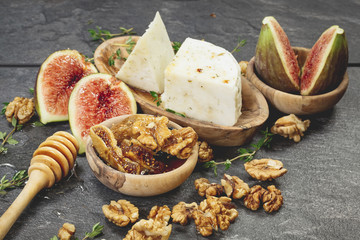 Cheese and fresh figs with honey and nuts