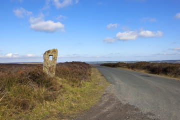 moorland road with monolith