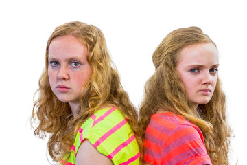 Two angry girls isolated on white background