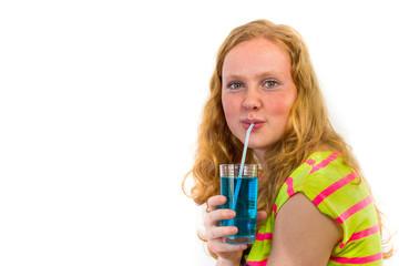 Redhead girl drinking soft drink