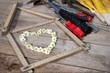 canvas print picture - Herz aus Kamille mit einem Zollstock