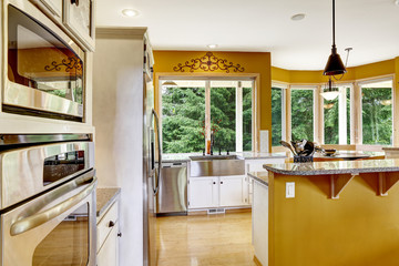 Farm house interior. Kitchen room in bright yellow color.