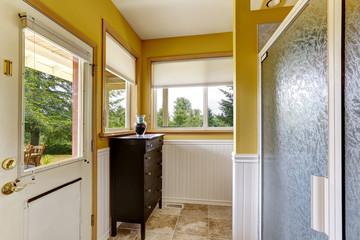 Farm house interior. Bathroom with exit to backayrd