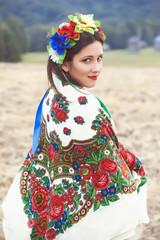 beautiful young woman wearing national ukrainian clothes posing