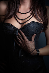 woman wearing corset and fashion jewelry in retro style