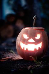 halloween jack-o-lantern standing on ground
