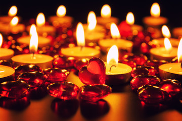 Candles and decorative red heart