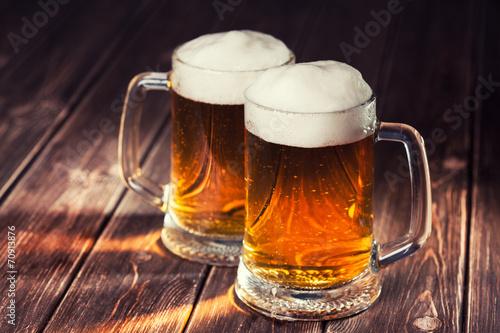 mug of beer on wooden background - 70913876