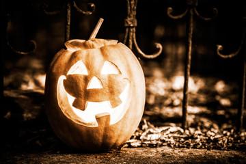 halloween jack-o-lantern on autumn leaves