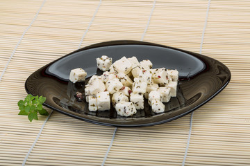 Cheese with spices and oil
