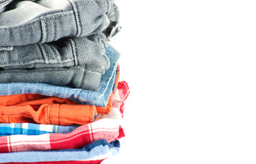 Stack of jeans isolated on white background.