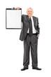 Mature man in formalwear holding a clipboard