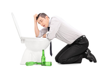 Drunk guy leaning over a toilet
