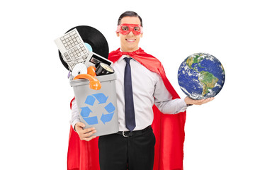 Superhero holding the world and a recycle bin