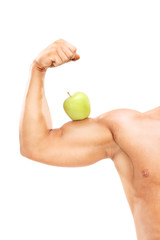 Muscular arm with an apple on the bicep