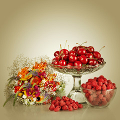 Sweet cherry and raspberry  in vase