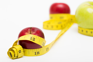 red apple and measuring tape