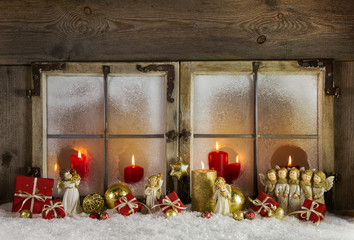 Weihnachtsfenster in rot gold mit Kerzen als Weihnachtskarte