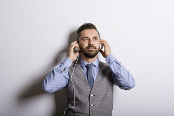 Hipster businessman with headphones