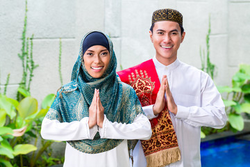 Asian Muslim couple wearing traditional dress