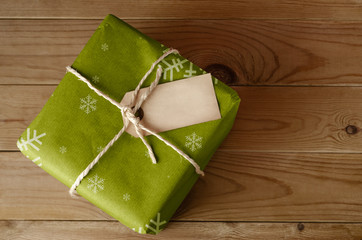 String Tied Green Christmas Parcel