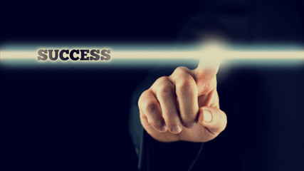 Man activating a bar with the word - Success