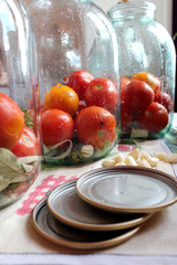 tomatos in jars prepared for preservation