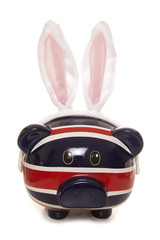 British piggy bank with easter rabbit ears