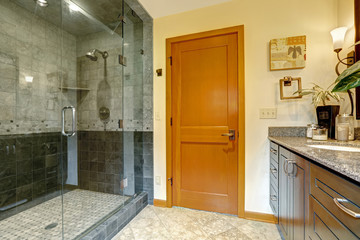 Modern bathroom interior with glass door shower