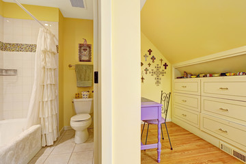Double kids bathroom interior with storage cabinet and table