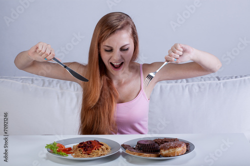 canvas print picture Girl eating a lot of food at once
