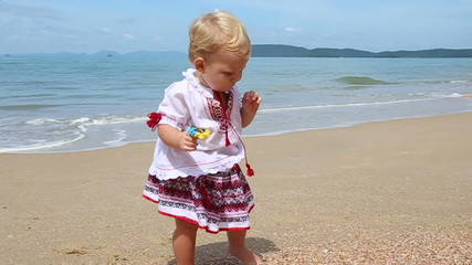 Little girl in the national Ukrainian costume embroidery walking