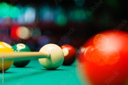 Leinwandbild Motiv Billiard balls in a pool table.