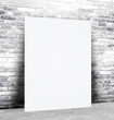 Blank paper poster and brick wall background, template
