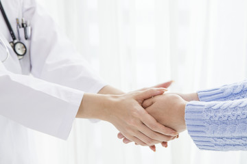 Doctor you are shaking hands with both hands