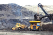 Haul Trucks being loaded with ore. - 70923028