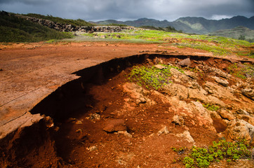 Hawaiian landscape with red crumbling soil