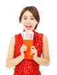 happy  woman holding a red envelope.happy chinese new year
