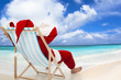 Santa Claus sitting on beach chairs with blue sky and cloud - 70923449