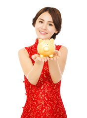 asian woman holding a golden piggy bank . happy chinese new year