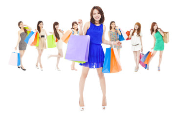 happy asian shopping women holding color bags.
