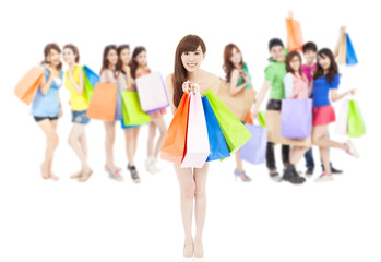 asian shopping women group holding color bags. isolated on white