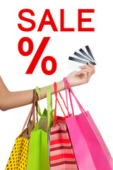 Hand show credit cards  with shopping bags with Sale sign