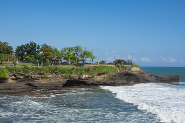 The ancient temple on the coast of the ocean. Bali, Indonesia