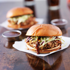 pulled pork barbecue sandwiches with condiment cups