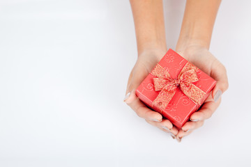 Hand hold red gift box