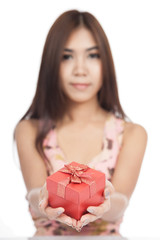 Beautiful Asian woman with red gift box focus on box