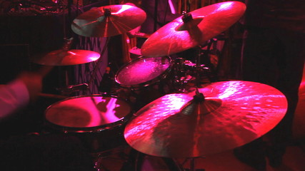 Rock band performing in a nightclub. drummer playing on drum set